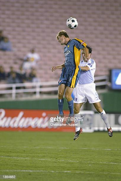Sasha Victorine of the Los Angeles Galaxy wins a header over Kerry Zavagnin of the Kansas City Wizards during the second half on August 21 2002 at...