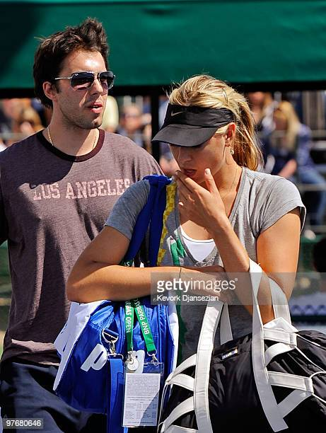Sasha Vujacic of the Los Angeles Lakers and Maria Shapova of Russia leave the court after her practice during the BNP Paribas Open on March 13 2010...
