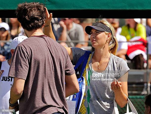 Sasha Vujacic of the Los Angeles Lakers and Maria Shapova of Russia on court at her practice during the BNP Paribas Open on March 13 2010 in Indian...
