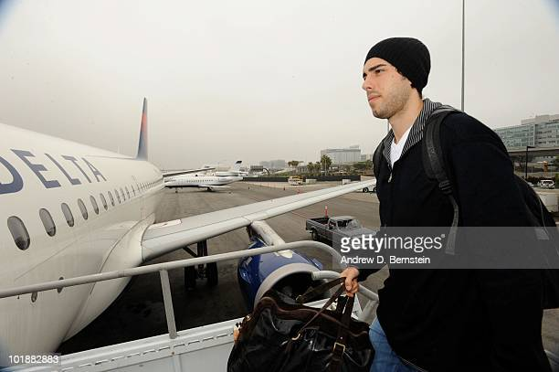 Los angeles lakers sasha vujacic stock photos and pictures getty sasha vujacic of the los angeles lakers boards the team plane to boston for game three voltagebd Images