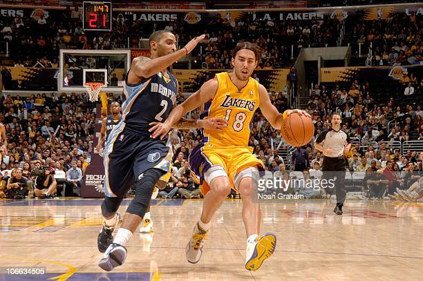 Sasha Vujacic of the Los Angeles Lakers drives against Acie Law of the  Memphis Grizzlies during 4a25c5498