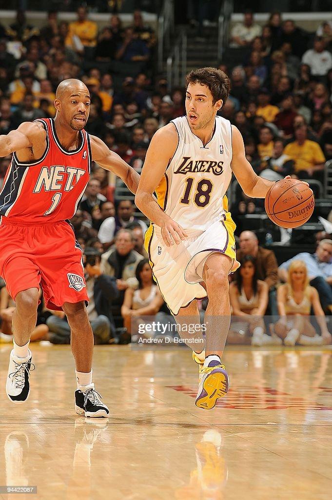 6b38446359c Sasha Vujacic of the Los Angeles Lakers drives the ball against ...