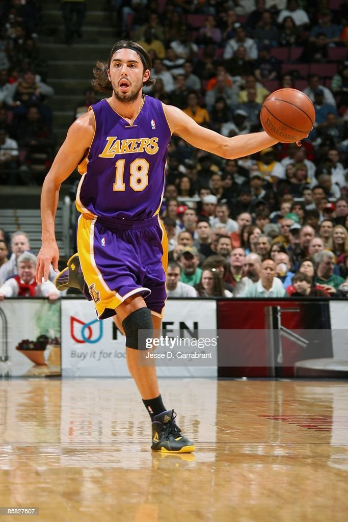 bf7d20f52 Sasha Vujacic of the Los Angeles Lakers drives the ball up court ...