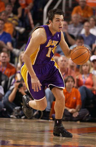Sasha Vujacic  18 of the Los Angeles Lakers moves the ball up court against  the 6579ac82f