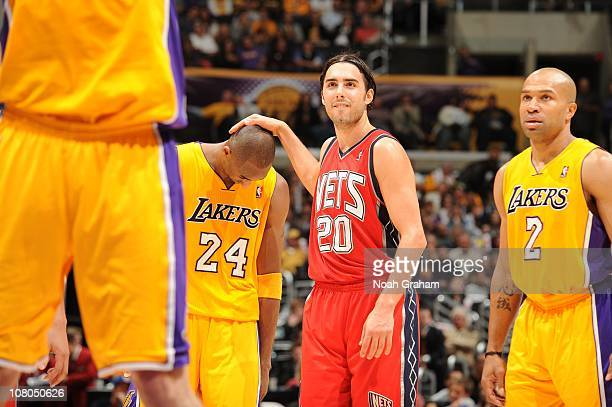 Sasha Vujacic of the New Jersey Nets puts his hand on the head of former teammate Kobe Bryant of the Los Angeles Lakers at Staples Center on January...