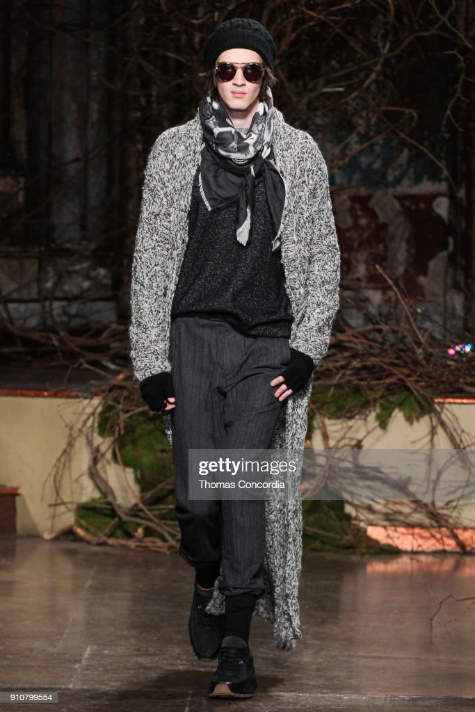 Sasha walks the runway wearing John Varvatos Fall/Winter 2018 with makeup by Chika Chan for Make-Up Pro and Hair by Yannik D'Is for Cultler/Redken at the Angel Orensanz Foundation on January 26, 2018 in New York City.