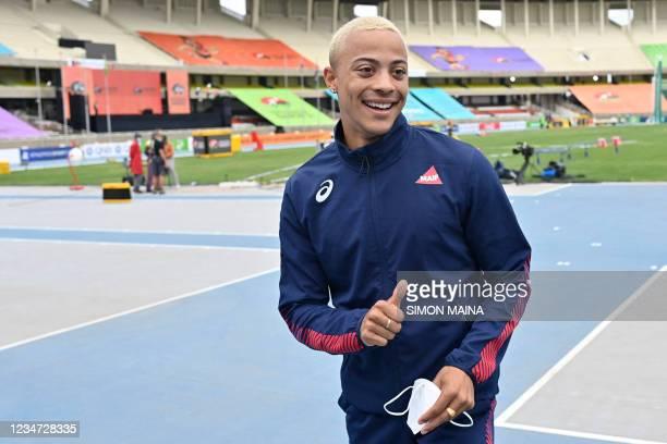 Sasha Zhoya, a French-Australian-Zimbabwean athlete, gestures inside the racing track ahead of World Under 20 Championships at the Moi International...