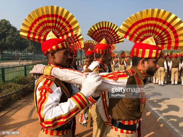Sashastra Seema Bal soldiers relax by massaging each other during their rehearsal for the Republic Day parade on a winter morning in New Delhi....