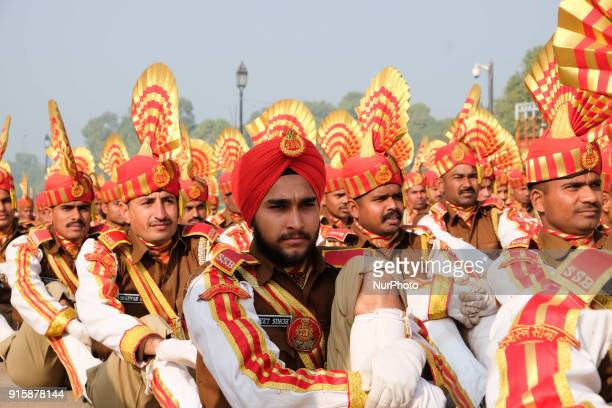Sashastra Seema Bal soldiers stretch while sitting on Rajpath during their rehearsal for the Republic Day parade on a winter morning in New Delhi....