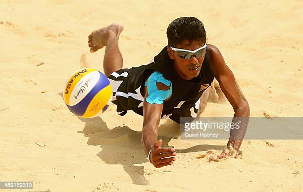 Sashima Yapa Hamillage of Sri Lanka dives for a ball during the Men's Volleyball match between Sri Lanka and Oman at the 2014 Asian Beach Games at...