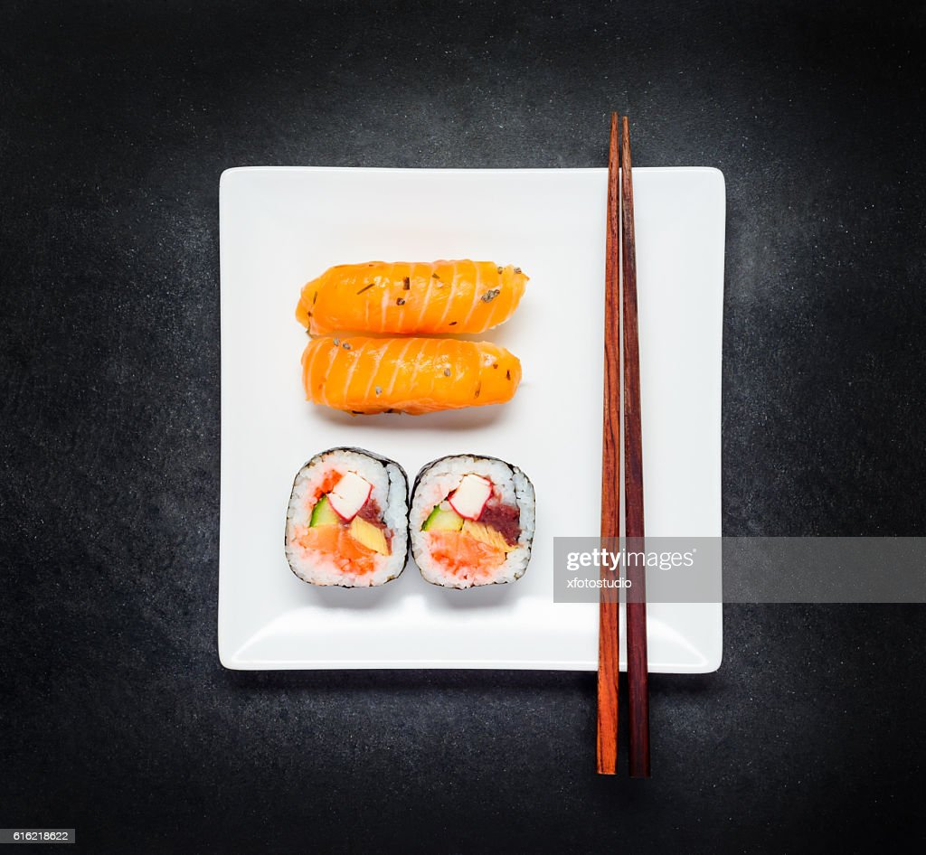 Sashimi and Sushi on Plate with Chopsticks : Stock Photo