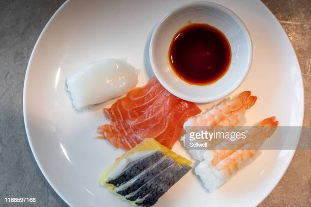 sashimi and sushi on the plate - soy sauce stock photos and pictures