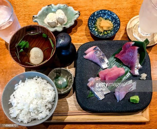 sashimi lunch meal served on table - takuan stock photos and pictures