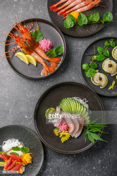 sashimi on the blackbackground - japanese food stock pictures, royalty-free photos & images