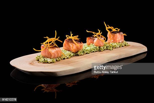 sashimi on wood plate - sashimi fotografías e imágenes de stock