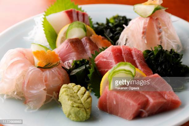 sashimi , sliced raw fish - washoku fotografías e imágenes de stock