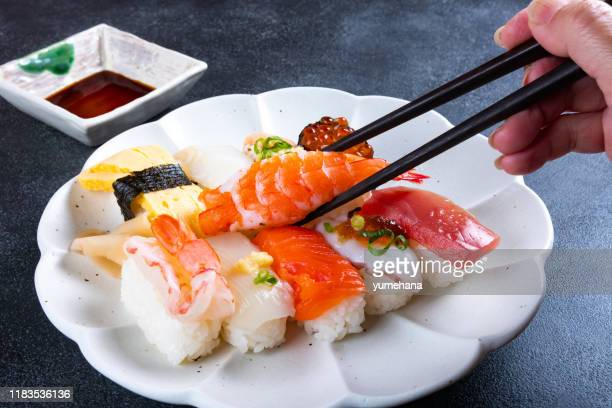 sashimi sushi set on plate japanese food - nigiri stock pictures, royalty-free photos & images