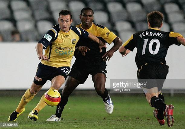 Sasho Petrovski of the Mariners and Cleberson and Michael Ferrante of the Phoenix contest the ball during the round one A-League Pre-Season Cup match...
