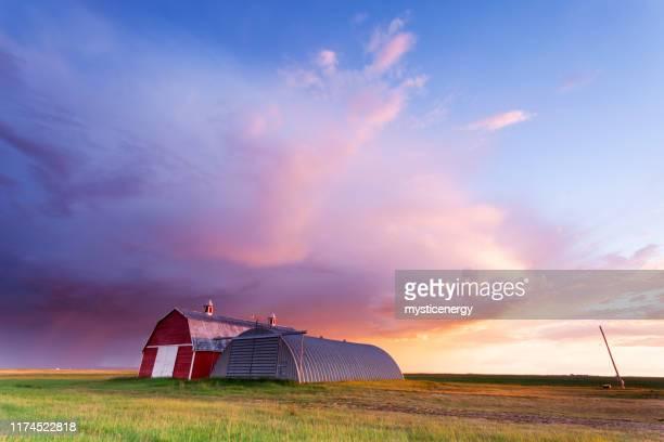 saskatchewan red barn storm chasing - saskatchewan stock pictures, royalty-free photos & images