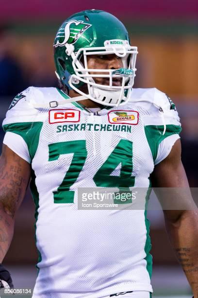 Saskatchewan Roughriders defensive lineman Makana Henry runs drills during warmup before Canadian Football League action between Saskatchewan...
