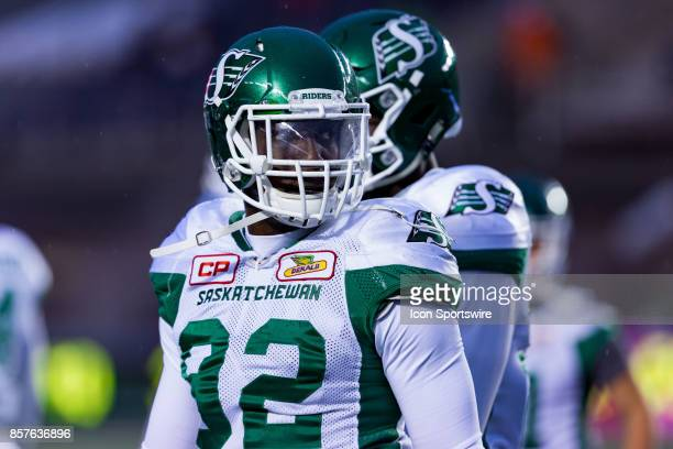 Saskatchewan Roughriders defensive lineman Tobi Antigha on the field after player entrance before Canadian Football League action between...