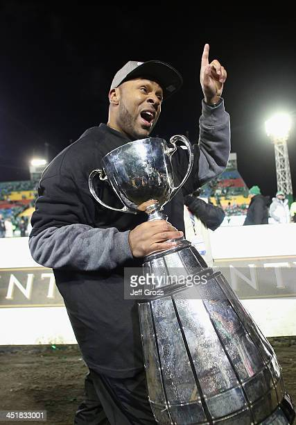 Saskatchewan Roughriders head coach Corey Chamblin celebrates with the Grey Cup following his teams 4523 victory over the Hamilton TigerCats during...