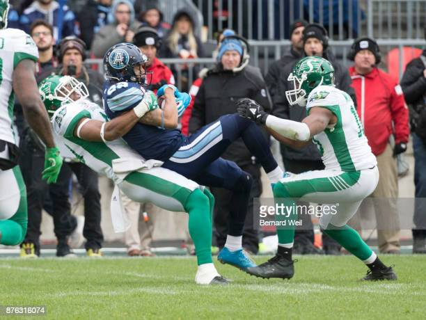 TORONTO ON NOVEMBER 19 Saskatchewan Roughriders linebacker Jeff Knox Jr pulls down Toronto Argonauts wide receiver DeVier Posey in the 2nd quarter as...