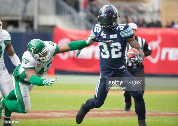 TORONTO ON NOVEMBER 19 Saskatchewan Roughriders linebacker Samuel Eguavoen gets a hold of Toronto Argonauts running back James Wilder Jr in the 1st...