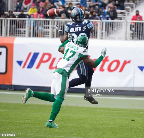 TORONTO ON NOVEMBER 19 Saskatchewan Roughriders linebacker Samuel Eguavoen makes the tackle on Toronto Argonauts running back James Wilder Jr in the...