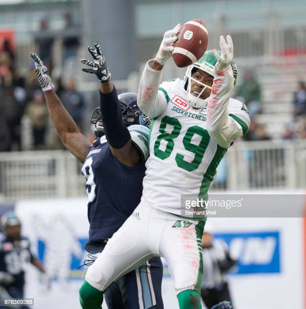 TORONTO ON NOVEMBER 19 Saskatchewan Roughriders wide receiver Duron Carter makes the catch past Toronto Argonauts defensive back Akwasi OwusuAnsah in...