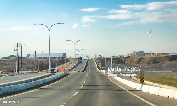 saskatoon north commuter parkway intersection - south saskatchewan river stock photos and pictures