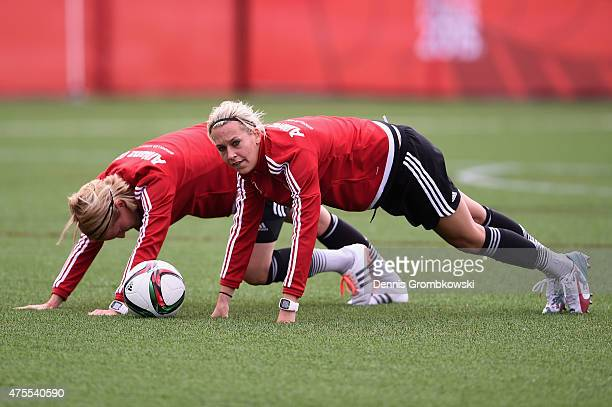 Saskia Bartusiak and Lena Goessling of Germany stretch during a training session at Richcraft Recreation Center on June 1 2015 in Ottawa Canada