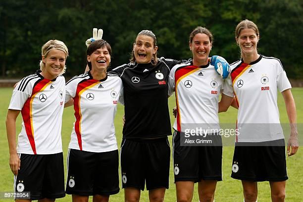 Saskia Bartusiak Ariane Hingst Nadine Angerer Birgit Prinz and Kerstin Garefrekes make fun during a photo call of the German women's national soccer...