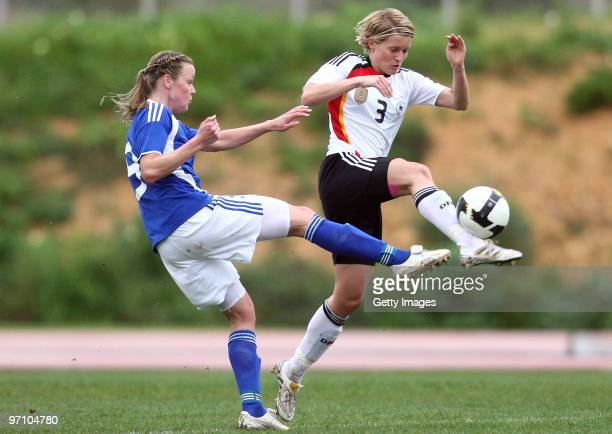 Saskia Bartusiak of Germany and Laura Kalmari of Finland battle for the ball during the Woman's Algarve Cup match between Germany and Finland at the...