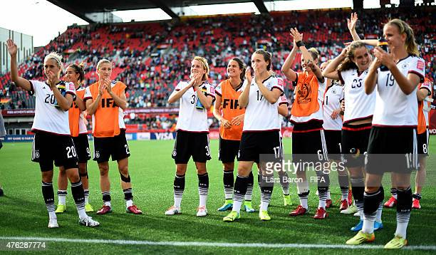 Saskia Bartusiak of Germany and team mates celebrate after winning the FIFA Women's World Cup 2015 Group B match between Germany and Cote D'Ivoire at...