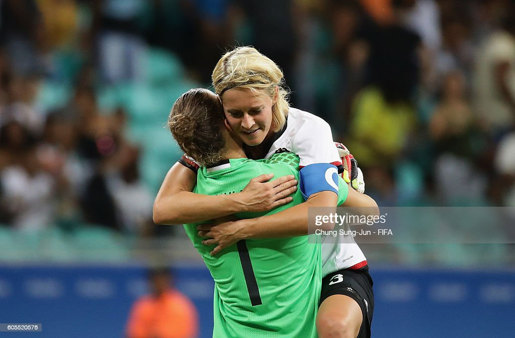 Saskia Bartusiak of Germany celebrates with Almuth Schult victory over the China after the Women's Football Quarter Final match between China and Germany on Day 7 of the Rio 2016 Olympic Games at Arena Fonte Nova on August 12, 2016 in Salvador, Brazil.