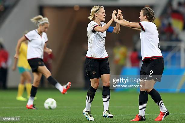 Saskia Bartusiak of Germany celebrates with Josephine Henning after scoring a goal against Australia in the second half in the Women's First Round...