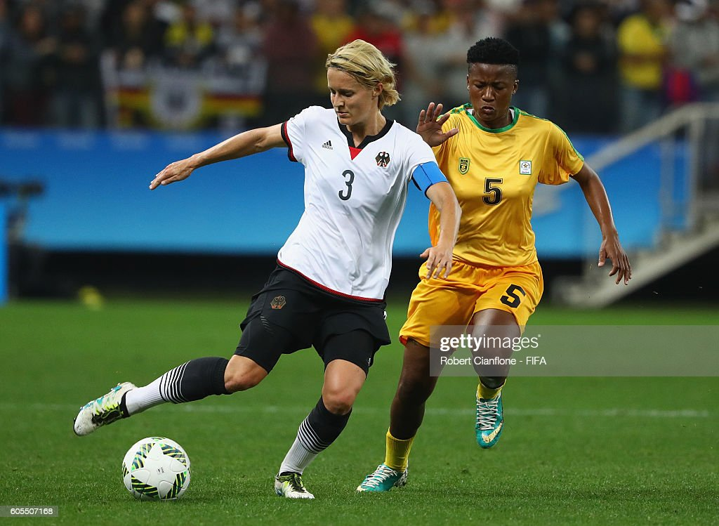 Saskia Bartusiak of Germany is chased by Msipa Emmaculate of Zimbabwe during the Women's First Round Group F match between Zimbabwe and Germany at Arena Corinthians on August 3, 2016 in Sao Paulo, Brazil.