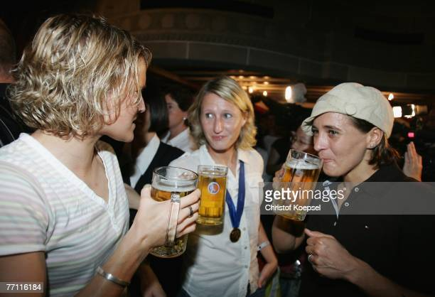 Saskia Bartusiak Sonja Fuss and Sandra Smisek celebrate during the German Womens National team party following the world cup final at the Hua Ting...