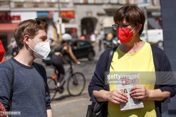 Saskia Esken , co-head of the German Social Democrats , and Kevin Kuehnert , deputy SPD head, meet to the launch of the SPD's door-to-door...