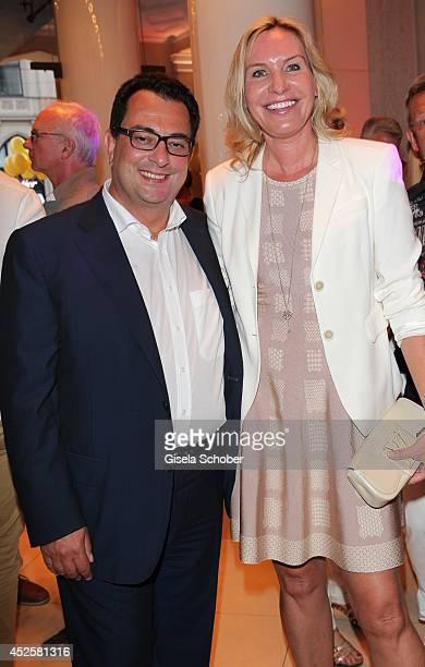 Saskia Greipl and her husband Stavros Kostantinidis attend the Eclat Dore summer party at Hotel Vier Jahreszeiten Kempinski on July 23 2014 in Munich...