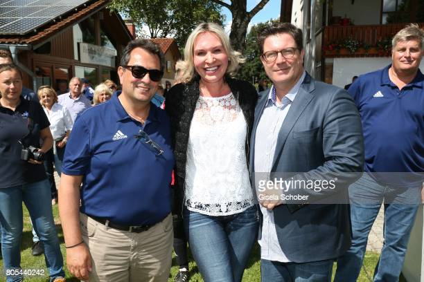 Saskia Greipl and her husband Stavros Kostantinidis L and Francis Fulton Smith during the Erich Greipl Tribute tournament and charity soccer game at...
