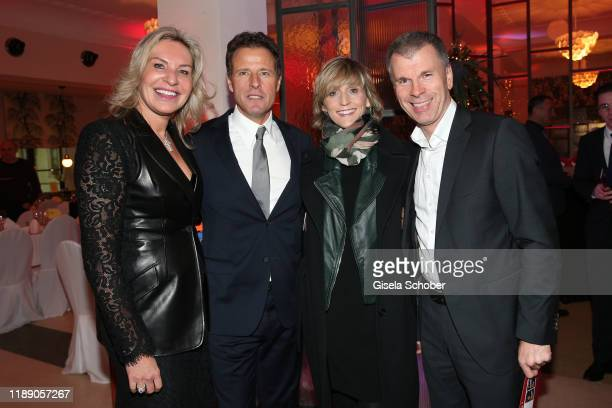 Saskia GreiplKostantinidis Helmut Kaes BMW Welt Peter Mey and his wife Candy Mey BMW location Munich during the annual christmas roast kid dinner at...