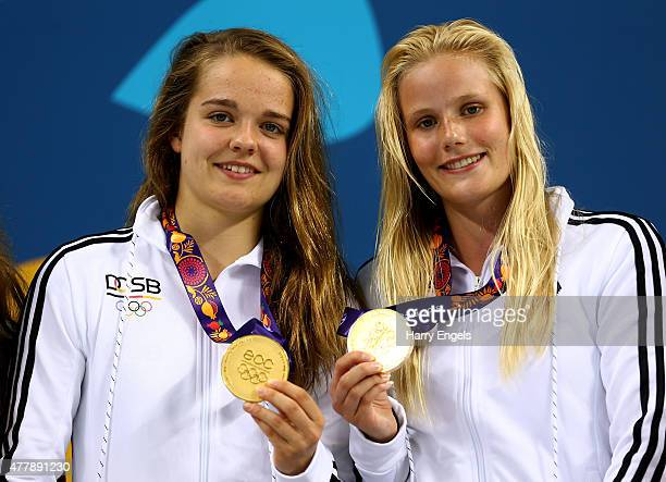 Saskia Oettinghaus and Louisa Stawczynski of Germany celebrate with the medals won during the Women's Synchronised 3m Springboard final on day eight...