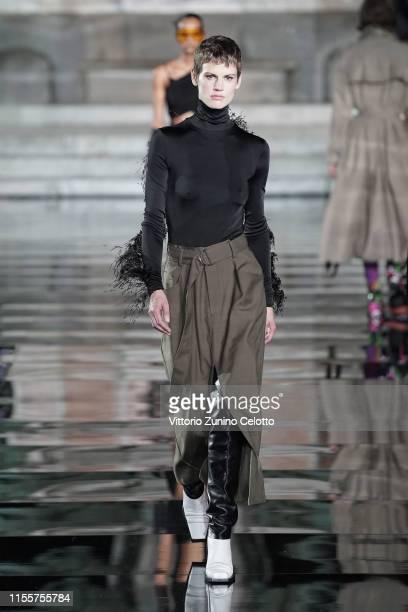 Saskia walks the runway, wearing Proenza Schouler, at the CR runway x LUISAVIAROMA 90th Anniversary Show during Pitti Immagine Uomo 96 on June 13,...