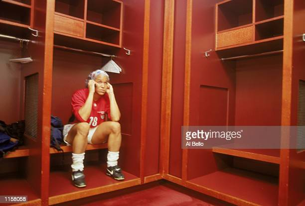 Saskia Webber of Team USA sits in the locker room having a post game phone call after the Womens World Cup Quarterfinals match against Team Germany...