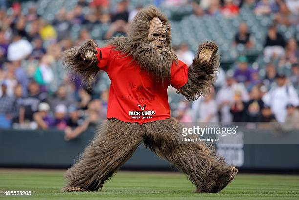 Sasquatch throws out the first pitch as part of a promotion as the Philadelphia Phillies face the Colorado Rockies at Coors Field on April 18 2014 in...