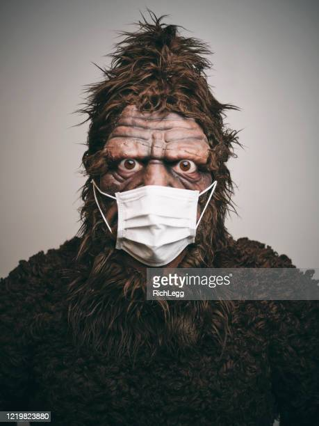 sasquatch wearing a mask - bigfoot foto e immagini stock