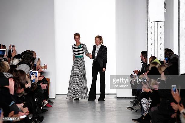 Sass Bide designers SarahJane Clarke and Heidi Middleton walk the runway at the Sass Bide fashion show during MercedesBenz Fashion Week Fall 2014 at...