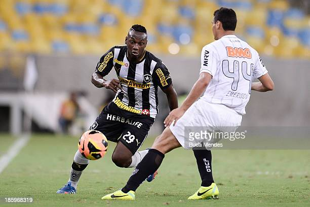 Sassa of Botafogo struggles for the ball with Emerson of Atletico MG during a match between Botafogo and Atletico MG as part of Brazilian Serie A...